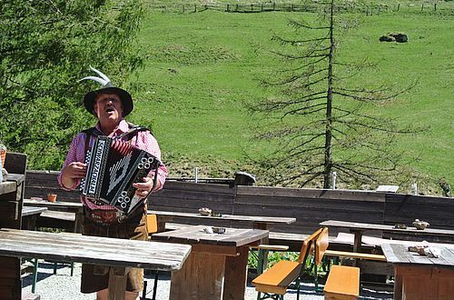 Hans entertains daily in summer on his accordion.