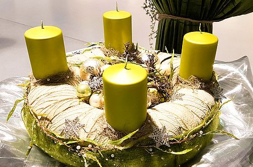 Festive advent wreath made from natural materials and the underside of a fragrant viburnum